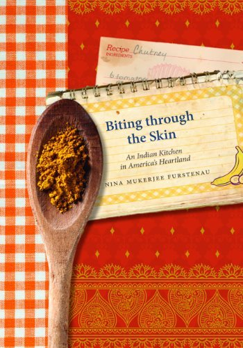 """Book cover of """"Biting through the Skin : An Indian Kitchen in America's Heartland"""""""