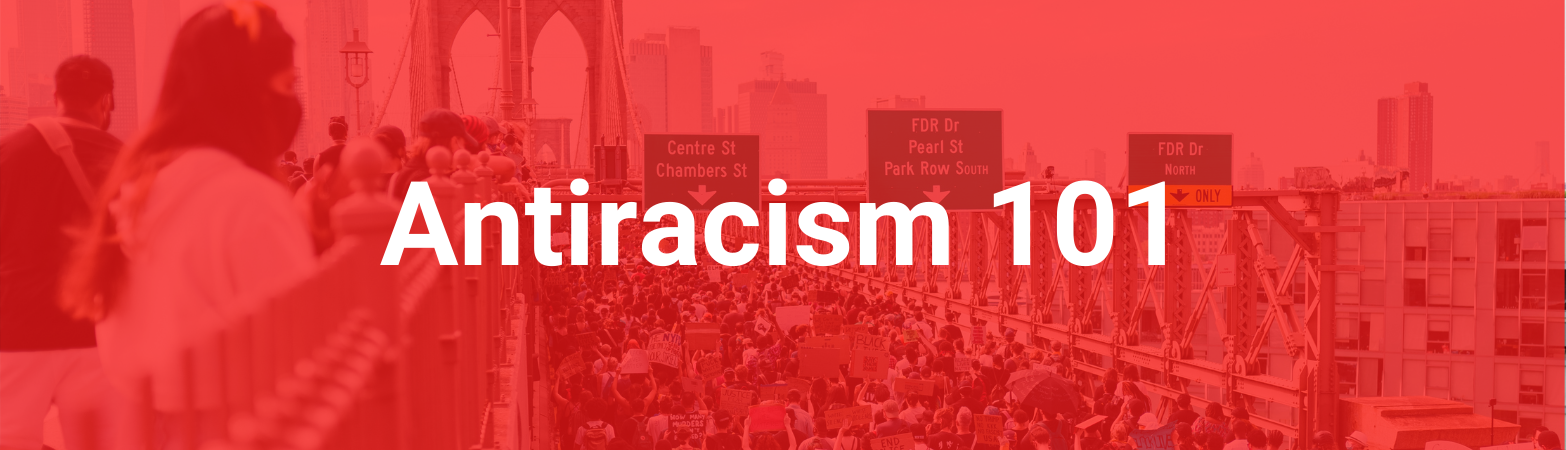 """A crowd of activists on a bridge and highway. Text states, """"Antiracism 101"""""""